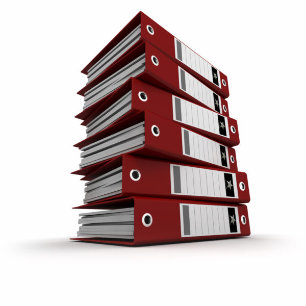 A pile of red ring binders against a white background